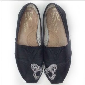 TOMS embroidered black butterfly slip on …